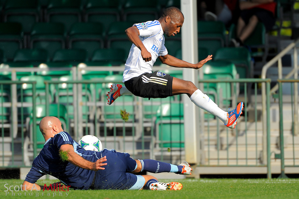 Montreal Impact midfielder Hassoun Camara (6) leaps over Sporting KC defender Aurelien Collin (78) during the Disney Pro Soccer Classic on Feb 9, 2013  in Lake Beuna Vista, Florida. ..©2013 Scott A. Miller