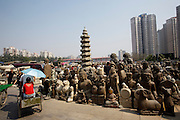 Panjiayuan weekend market. Buddha statues in all sizes.