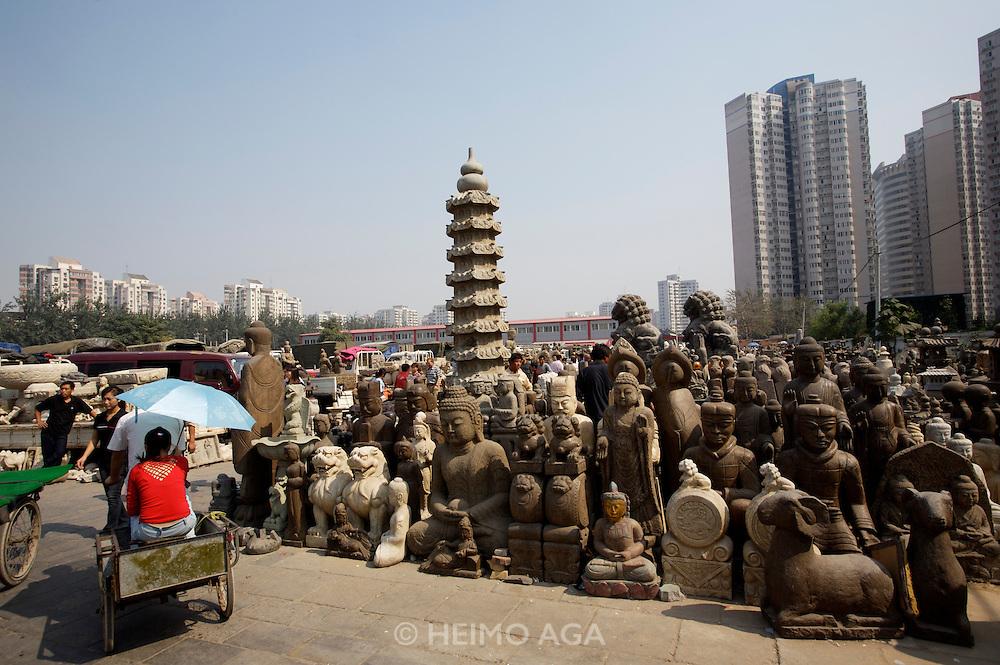 Panjiayuan weekend market. Buddha statues in all sizes.