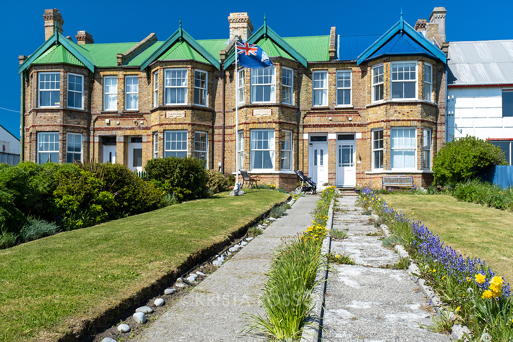 The Jubilee Villas are English 19th century brick terrace houses roofed Falkland style with corrugated iron, located in Stanley, East Falkland Island, Falkland Islands.