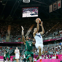 06 August 2012: France Nicolas Batum goes for the layup past Nigeria Alade Aminu during 79-73 Team France victory over Team Nigeria, during the men's basketball preliminary, at the Basketball Arena, in London, Great Britain.
