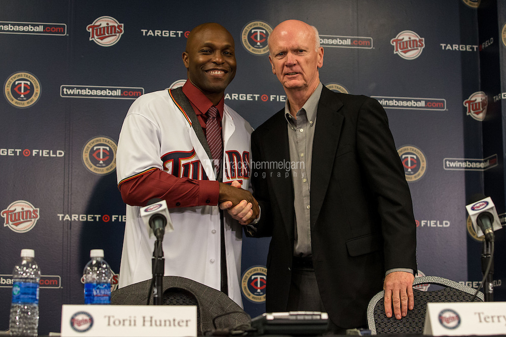 MINNEAPOLIS, MN- DECEMBER 03: Minnesota Twins general manager Terry Ryan presents Torii Hunter #48 to the media  on December 3, 2014 at Target Field in Minneapolis, Minnesota. (Photo by Brace Hemmelgarn) *** Local Caption *** Terry Ryan;Torii Hunter