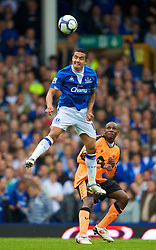 LIVERPOOL, ENGLAND - Sunday, August 30, 2009: Everton's Tim Cahill in action against Wigan Athletic during the Premiership match at Goodison Park. (Photo by David Rawcliffe/Propaganda)