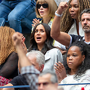 2019 US Open Tennis Tournament- Day Thirteen.    Meghan Markle, Duchess of Sussex reacts to a point while sat next to Oracene Price, mother of Serena Williams and coach Patrick Mouratoglou in the the team box watching Serena Williams of the United States in action against Bianca Andreescu of Canada in the Women's Singles Final on Arthur Ashe Stadium during the 2019 US Open Tennis Tournament at the USTA Billie Jean King National Tennis Center on September 7th, 2019 in Flushing, Queens, New York City.  (Photo by Tim Clayton/Corbis via Getty Images)