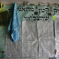 List of names and phone numbers of people who found their pairing after visiting the Rabbi's tomb, are displayed at the shop outside the grave of Yonatan ben Uziel at Amukah in the Galilee in Israel. Over the centuries the tradition developed that those seeking for their soul-mates would be married within one year if they prayed at Rabbi Ben-Uziel's tomb.