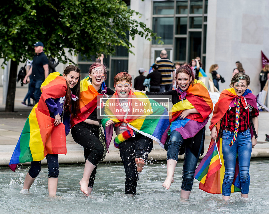 Friends Darren Carley, Mairi Spence, Ruby Smith, Macie Deas and Elidh Spence cool off before the annual Pride Edinburgh march took place from outside the Scottish Parliament.<br /> <br /> © Dave Johnston/ EEm