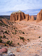 View of the Cathedral Valley area of Capitol Reef National Park, with the Sevier Plateau and Fish Lake National Forest in the background.
