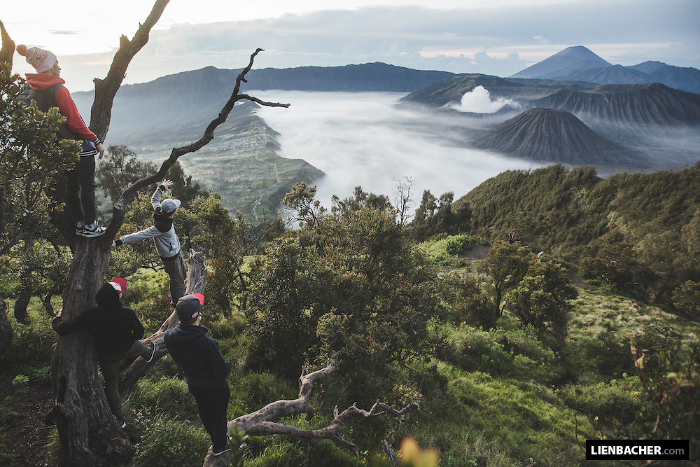 Members of the Red Bull Skydive Team, Marco Waltenspiel, Georg Lettner, Dominic Roithmair and Marco Fuerst discuss the location in the first sunrise at Mount Bromo in Indonesia, February 27th 2015