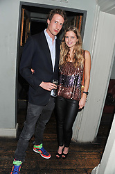 The HON.FREDDIE HESKETH and KATIE READMAN at a carnival themed party hosted by Stacey Bendet for the Alice & Olivia fashion label at Paradise, Kensal Green, London on 9th November 2011