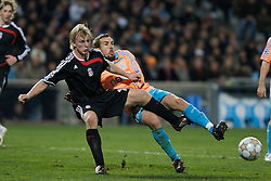 MARSEILLE, FRANCE - Tuesday, December 11, 2007: Liverpool's Dirk Kuyt and Olympique de Marseille's Gael Givet during the final UEFA Champions League Group A match at the Stade Velodrome. (Photo by David Rawcliffe/Propaganda)