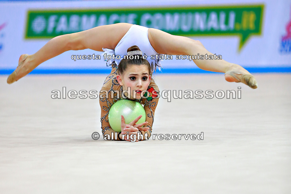 """Araujo Rita during ball routine at the International Tournament of rhythmic gymnastics """"Città di Pesaro"""", 02 April,2016. Rita is an Portuguese individualistic gymnast, born in Almada, 2003.<br /> This tournament dedicated to the youngest athletes is at the same time of the World Cup."""