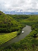 View of Wailua River and people kayaking, near Lihue, Kauai, Hawaii, US.