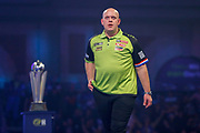 Michael Van Gerwen (Netherlands) walks off the stage looking slightly worried during his match with Peter Wright (Scotland)  (not in picture) in the final of the PDC William Hill World Darts Championship at Alexandra Palace, London, United Kingdom on 1 January 2020.