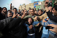 An Egyptian Secret Service agent is discovered by the crowd in Tahrir Square in Cairo, Egypt on Thursday, Feb. 3, 2011. The officer was beaten by the crowd and then dragged away for treatment and interrogation.