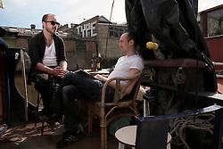 UK ENGLAND LONDON 30APR16 - London Canal boat resident Duncan Stevens with Jakob Horstmann (R) on his boat near Haggerston, east London.<br /> <br /> jre/Photo by Jiri Rezac<br /> <br /> © Jiri Rezac 2016