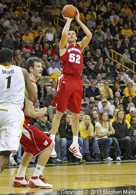 February 09 2011: Wisconsin Badgers forward Keaton Nankivil (52) puts up a shot during the first half of an NCAA college basketball game at Carver-Hawkeye Arena in Iowa City, Iowa on February 9, 2011. Wisconsin defeated Iowa 62-59.