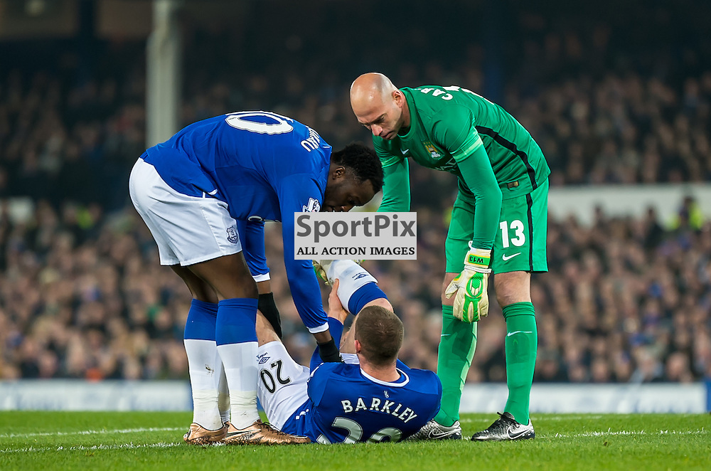 Everton forward Romelu Lukaku and Manchester City goalkeeper Wilfredo Caballero attend to the injured Everton midfielder Ross Barkley in the Football League cup semi-final first leg at Goodison Park, Liverpool