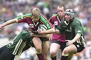 10/04/2002 - Powergen National Cup Final - Twickenham.London Irish vs Northampton..Saints Nick Beal, is held in the tackle by exiles Brendan Venter..