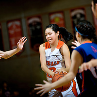 021613  Adron Gardner<br /> <br /> Gallup Bengal Kaylee Tsinginie (12) drives past the Los Lunas Tigers at Gallup High School February, 16.