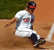 Cleveland baserunner Grady Sizemore scores a run on an RBI double by teammate Ronnie Belliard yesterday against Texas.