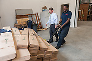 20181024, Wednesday, October 24, 2018, Dartmouth, MA, USA &ndash; My Brother's Keeper welcomed two sets of Bob's Discount Furniture delivery drivers to their Dartmouth location on Wednesday morning as the drivers unloaded much needed donated furniture to be soon delivered by the many hands of the My Brother's Keeper volunteers. <br /> <br /> Wednesday morning was Bob's Discount Furniture's second visit to the Dartmouth facility where they have now dontated many new mattresses, loveseats, and recliners to the still very new My Brother's Keeper Dartmouth facility on Wednesday October 24, 2018.  <br /> <br /> ( 2018 &copy; lightchaser photography )