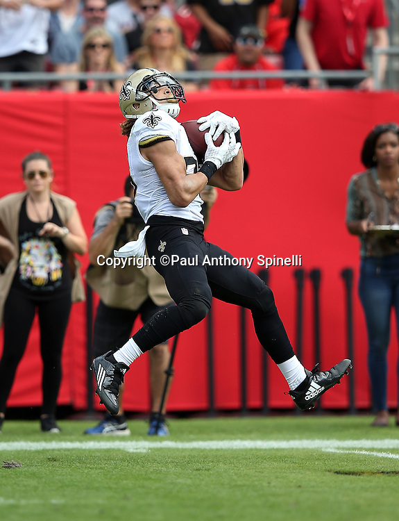 New Orleans Saints wide receiver Willie Snead (83) catches a deep pass for a gain of 41 yards to the Tampa Bay Buccaneers 22 yard line in the second quarter on a third down play with 21 yards to go for a first down during the 2015 week 14 regular season NFL football game against the Tampa Bay Buccaneers on Sunday, Dec. 13, 2015 in Tampa, Fla. The Saints won the game 24-17. (©Paul Anthony Spinelli)