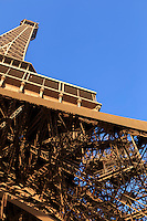 Looking up at the Eiffel Tower from its base in Paris, France.