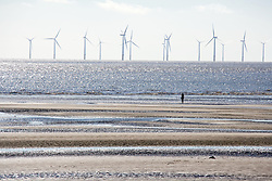 The Burbo Bank offshore wind farm which comprises 25 wind turbines in the distance from Waterloo Beach, The wind farm is capable of generating up to 90MW (megawatts) of clean; environmentally sustainable electricity; enough power for approximately 80;000 homes,