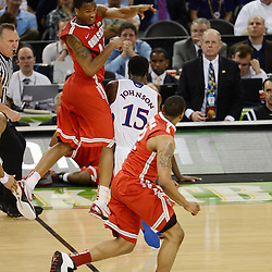 Mar 31, 2012; New Orleans, LA, USA; Ohio State Buckeyes guard William Buford (top left) passes to guard Lenzelle Smith, Jr. (bottom right) as Kansas Jayhawks guard Elijah Johnson (15) defends during the second half in the semifinals of the 2012 NCAA men's basketball Final Four at the Mercedes-Benz Superdome. Mandatory Credit: Derick E. Hingle-US PRESSWIRE
