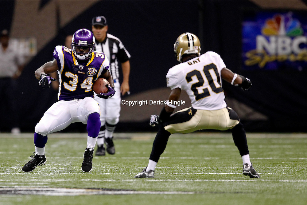 September 9, 2010; New Orleans, LA, USA;  Minnesota Vikings running back Albert Young (34) is pursued by New Orleans Saints cornerback Randall Gay (20) during the NFL Kickoff season opener at the Louisiana Superdome. The New Orleans Saints defeated the Minnesota Vikings 14-9.  Mandatory Credit: Derick E. Hingle