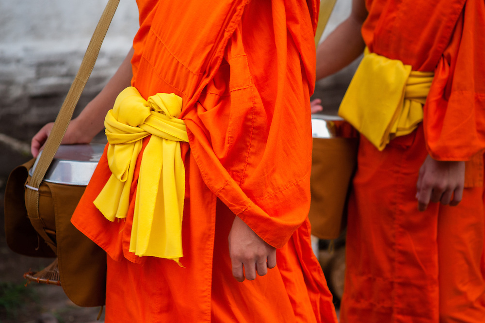 Buddhist monks after receiving daily alms at dawn in Luang Prabang (Laos).