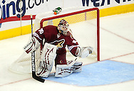 Apr 23, 2010; Glendale, AZ, USA; Phoenix Coyotes goalie Ilya Bryzgalov (30) makes a glove save during the second period of game five in the first round of the 2010 Stanley Cup Playoffs at Jobing.com Arena.  Mandatory Credit: Jennifer Stewart-US PRESSWIRE