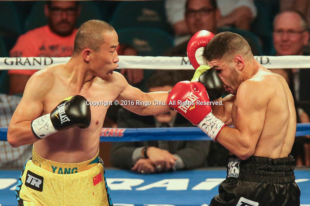 Chinese boxer Lianhui Yang fights against  Lenny Zappavigna during a 10 rounds super lightweight boxing match at the MGM Grand Garden Arena on July 23, 2016 in Las Vegas, Nevada. <br /> <br /> (Photo by Ringo Chiu/PHOTOFORMULA.com)<br /> <br /> Usage Notes: This content is intended for editorial use only. For other uses, additional clearances may be required.