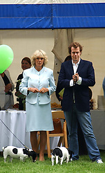 HRH The DUCHESS OF CORNWALL and her son TOM PARKER BOWLES at the 3rd annual Macmillan Dog Day in aid of Macmillan Cancer Relief held at Royal Hospital Chelsea, London SW3 on 5th July 2005.<br /><br />NON EXCLUSIVE - WORLD RIGHTS