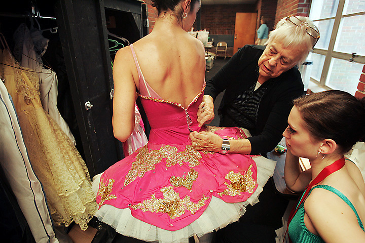 "galmh ""Nutcracker""---Seamstress Ruth Mock and Columbia City Ballet dancer and costume designer Alexis Doktor, right, make some final adjustments to  Regina Willoughby's costume during rehearsal for ""The Nutcracker"" at Patriot Hall in Sumter."