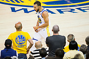 Golden State Warriors guard Stephen Curry (30) reacts to a call during Game 6 of the Western Conference Finals against the Houston Rockets at Oracle Arena in Oakland, Calif., on May 26, 2018. (Stan Olszewski/Special to S.F. Examiner)