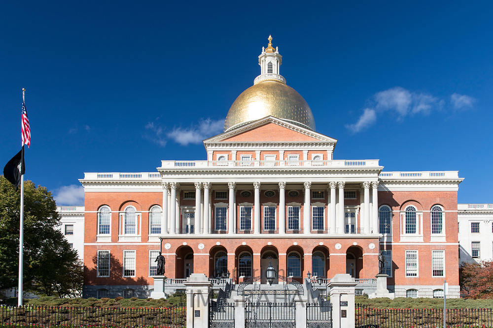 Massachusetts State House the seat of Government, with golden dome and patriotic Stars and Strips flag in the city of Boston, USA
