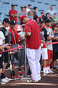 ANAHEIM, CA - JUNE 6:  Mike Trout #27 of the Los Angeles Angels of Anaheim signs autographs before the game against the Chicago White Sox at Angel Stadium on Friday, June 6, 2014 in Anaheim, California. The Angels won the game 8-4. (Photo by Paul Spinelli/MLB Photos via Getty Images) *** Local Caption *** Mike Trout