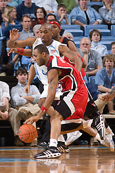 28 December 2006: North Carolina Tarheel forward (3) Reyshawn Terry defends Rutgers guard (32) Jaron Griffin during a 87-48 Rutgers Scarlet Knights loss to the North Carolina Tarheels, in the Dean Smith Center in Chapel Hill, NC.<br />
