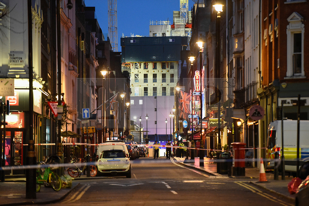 © Licensed to London News Pictures. 03/02/2020. LONDON, UK. A general view of Dean Street, where according to a firefighter, an unexploded WW2 bomb has been discovered in the foundations of a hotel. Scenes in Soho where the public have been evacuated by police and emergency services are in attendance after reports of an unexploded WW2 bomb being discovered in the area.  A wide cordon has been established from Shaftesbury Avenue, Charing Cross Road and the streets around Old Comption Street.  Photo credit: Stephen Chung/LNP
