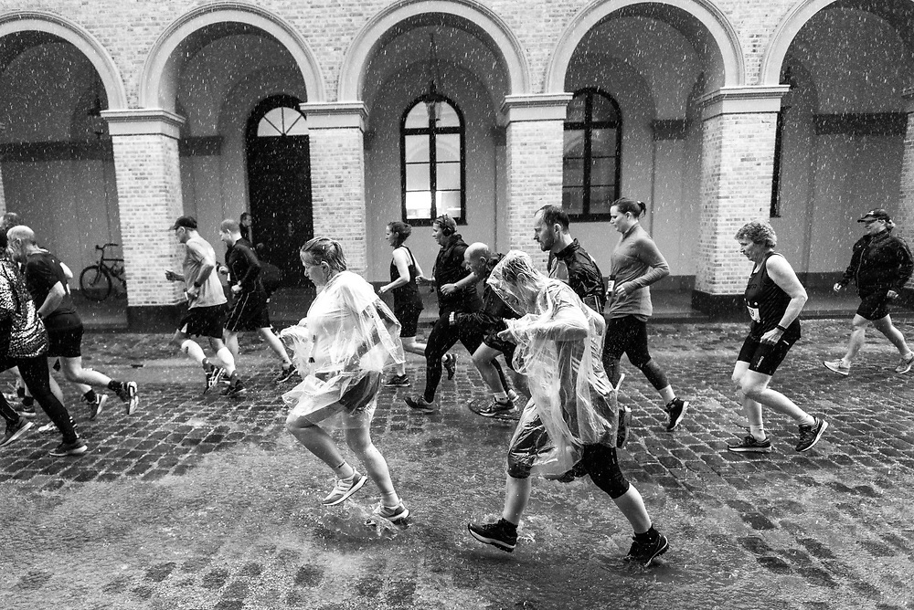 Runners braved the wet weather and slippy concrete during a summer race in Copenhagen