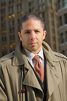 Portrait of a businessman wearing an overcoat in an urban setting
