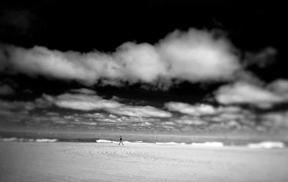 A lone walker strolls along Lake Michigan Saturday afternoon in Chicago..(Nikon Tilt-Shift Lense)