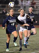 From left, Cedar Cliff's Maddy Hindermyer #13, CB East's Emma Loving #8 and Cedar Cliff's Abby Brown #10 chase after a ball in the first half Tuesday November 10, 2015 in Doylestown, Pennsylvania.  (Photo by William Thomas Cain)