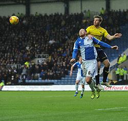 Johnny Mullins of Oxford United winsa high ball over Tom Parkes of Bristol Rovers - Mandatory byline: Alex James/JMP - 17/01/2016 - FOOTBALL - The Kassam Stadium - Oxford, England - Oxford United v Bristol Rovers - Sky Bet League Two
