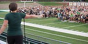 Jenny Hall-Jones, associate vice president for student affairs and dean of students, directs students on the field during the Class of 2020 photo on the field of Peden Stadium on Saturday, August 20, 2016. © Ohio University / Photo by Kaitlin Owens