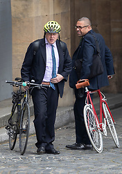FILE PICTURE © Licensed to London News Pictures. 29/04/2019. London, UK. Boris Johnson (L) stands with his bicycle in Parliament as Conservative Party Deputy Chairman James Cleverly looks on. Photo credit: Peter Macdiarmid/LNP