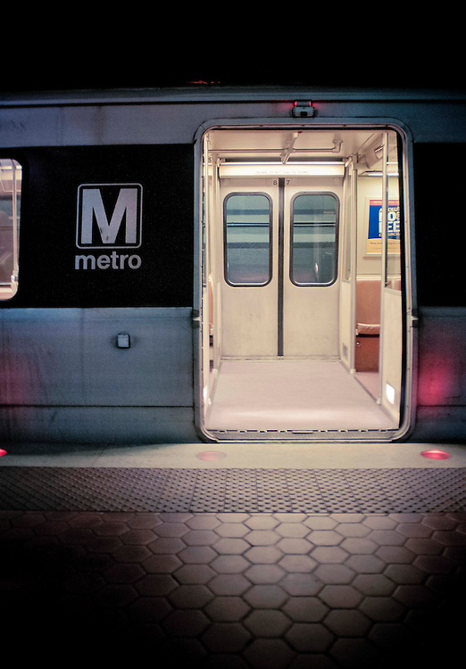 The metro carries millions of people each year under the bustling streets in heart of Washington, DC Virginia. This particular train was stopped at Farragut St. waiting for travelers to load and unload. No one was aboard this car.