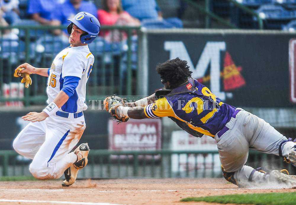 Oxford High's Grae Kessinger (15) avoids the tag from Hattiesburg catcher Devin Lang (28) to score in the MHSAA Class 5A championship series at Trustmark Park in Pearl, Miss. on Thursday, May 19, 2016. Oxford won 10-0 to win its second straight state title.
