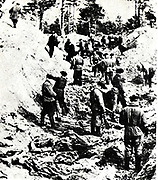 The Katyn massacre of thousands of Polish prisoners of war (primarily military officers),by the Soviet NKVD, based on a proposal from Lavrentiy Beria to execute all members of the Polish Officer Corps. The number of victims is estimated at about 22,000.Photo from 1943 exhumation of mass grave of polish officers killed by NKVD in Katy? Forest in 1940